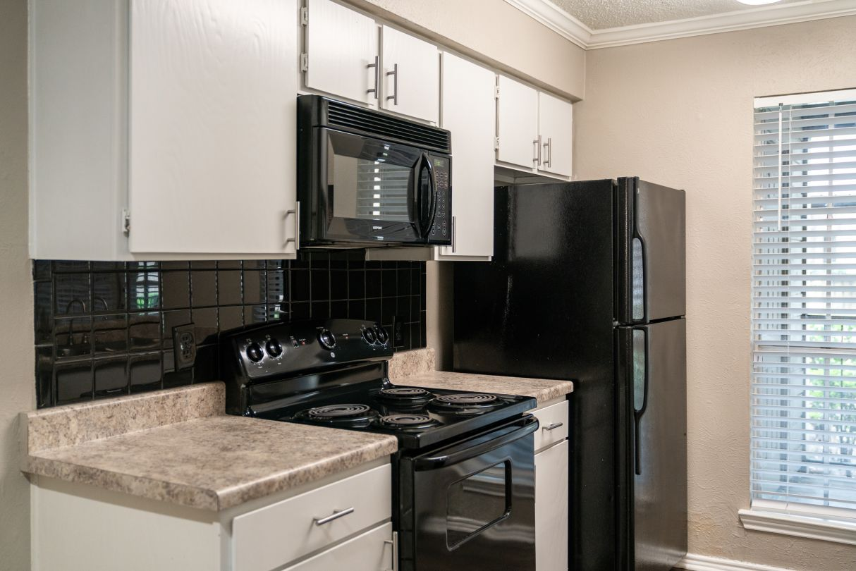 Black Appliance Package at Westmount at River Park Apartments in Fort Worth, TX