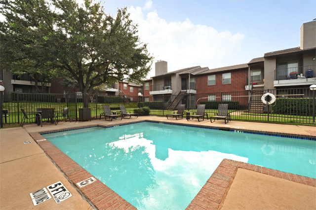 Poolside Lounge Area with Seating at Westwind Apartments in Denton, TX