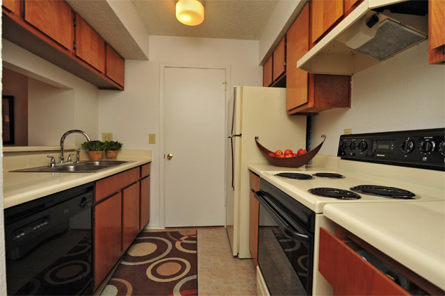 Modern Galley Kitchens at Westwind Apartments in Denton, TX