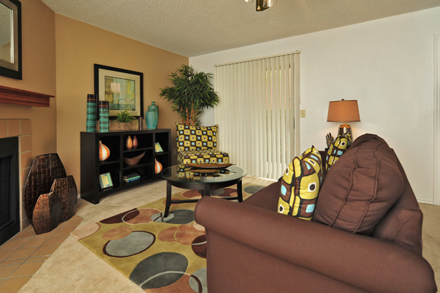 Entertainment Area with Fireplace at Westwind Apartments in Denton, TX