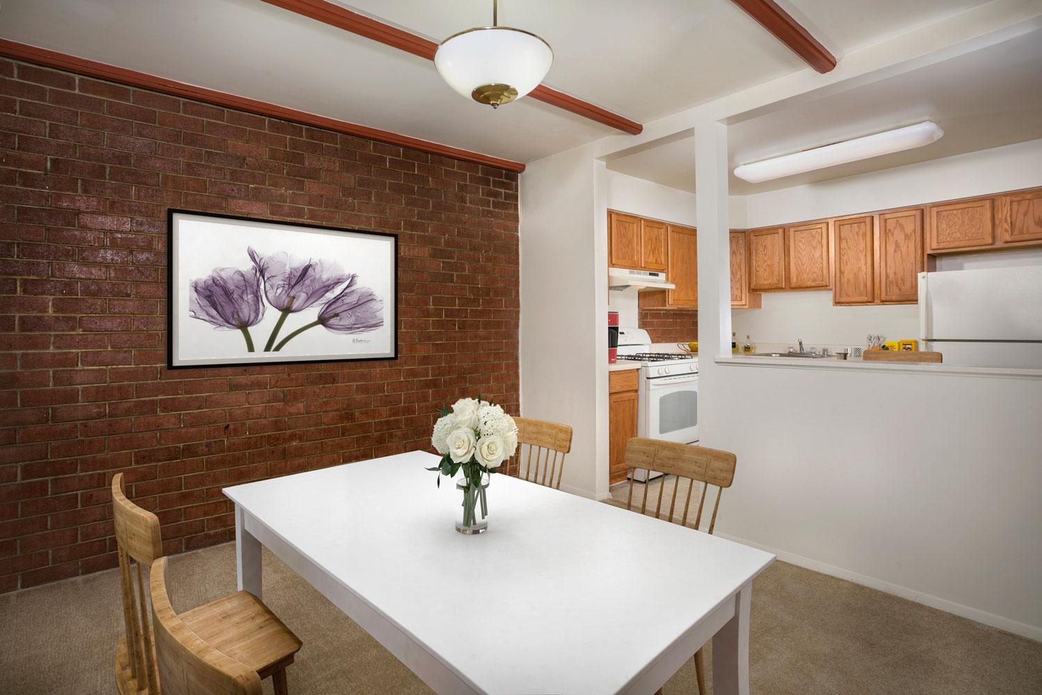 Separate dining area with exposed brick at Whitehall Square Apartments