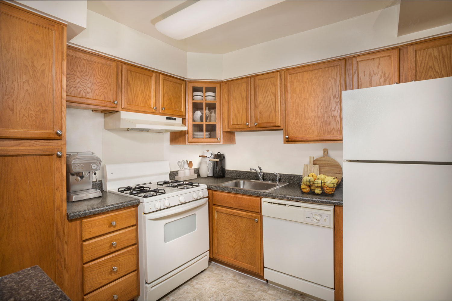 Fully-equipped kitchen with pantry at Whitehall Square Apartments in Suitland, MD