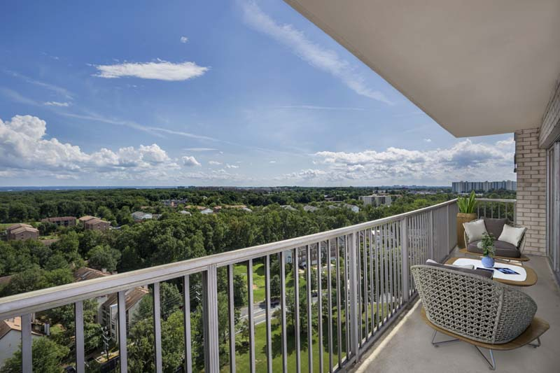 Large covered balcony at White Oak Towers Apartments in Silver Spring, MD
