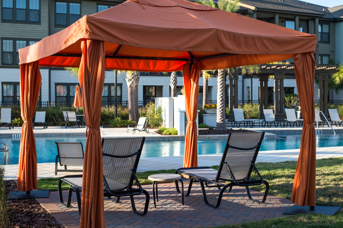Lounge beside the Pool at Whitepalm Luxury Apartment Homes in Port Orange, FL
