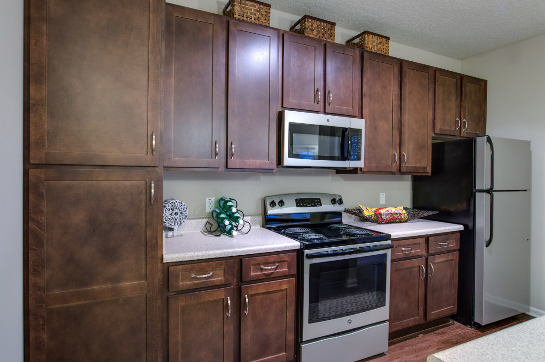 Kitchen with Cabinets at Whitepalm Luxury Apartment Homes in Port Orange, FL