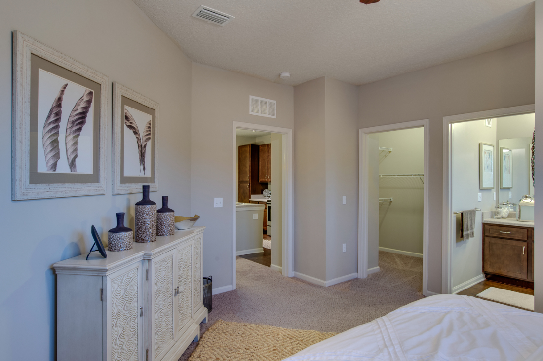 Bedroom with Bathroom at Whitepalm Luxury Apartment Homes in Port Orange, FL