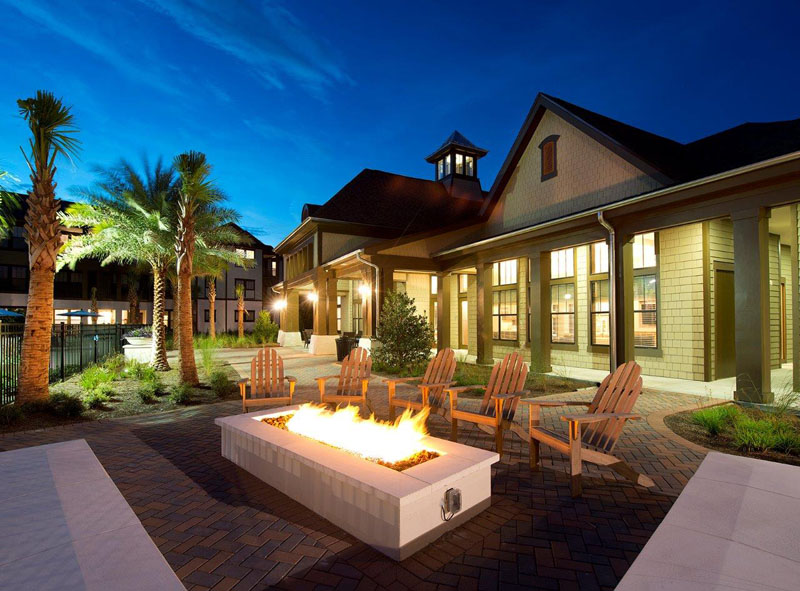 Outdoor Fire Pit with Seating at Whitepalm Apartments in Port Orange, FL