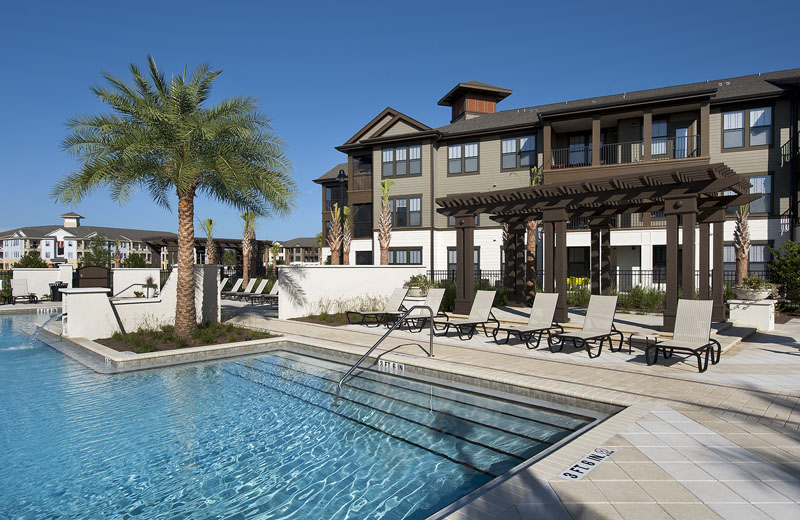 Outdoor Swimming Pool with Pergola at Whitepalm Apartments in Port Orange, FL