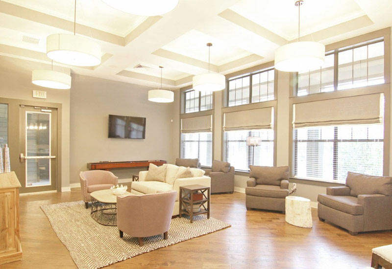 Community Clubhouse with Modern Interior at Whitepalm Apartments in Port Orange, FL