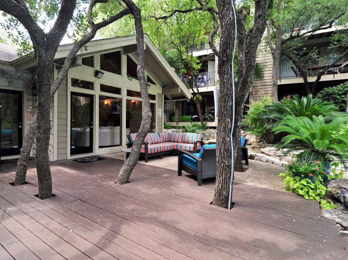 Outdoor Deck with Seating at Waters at Barton Creek Apartments in Austin, TX
