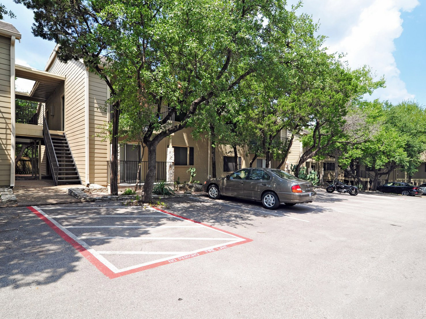 Spacious Parking Lot at Waters at Barton Creek Apartments in Austin, TX