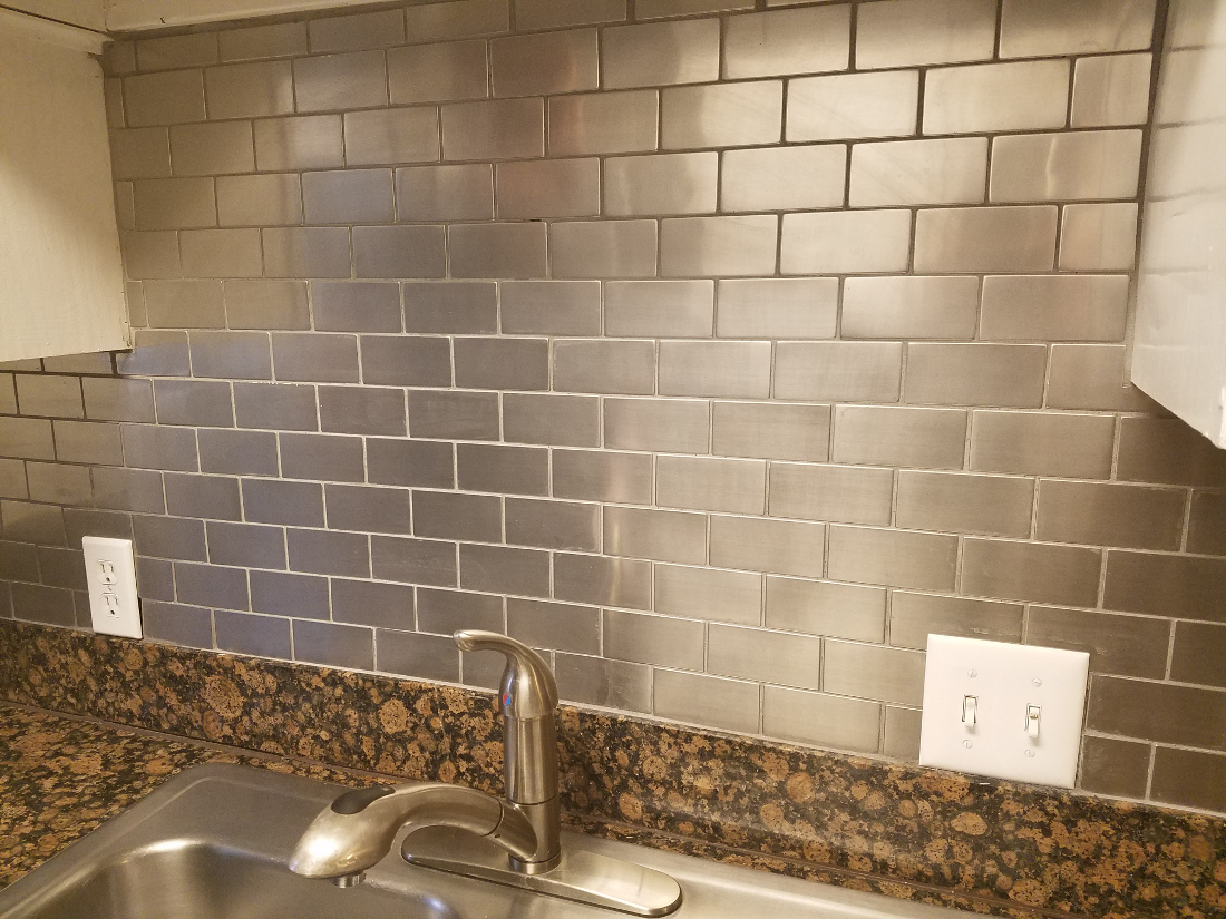 Subway and Mosaic Tile Backsplash at Waters at Barton Creek Apartments in Austin, TX