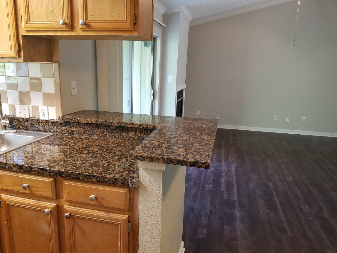 Eat-In Kitchen with Bar at Waters at Barton Creek Apartments in Austin, TX