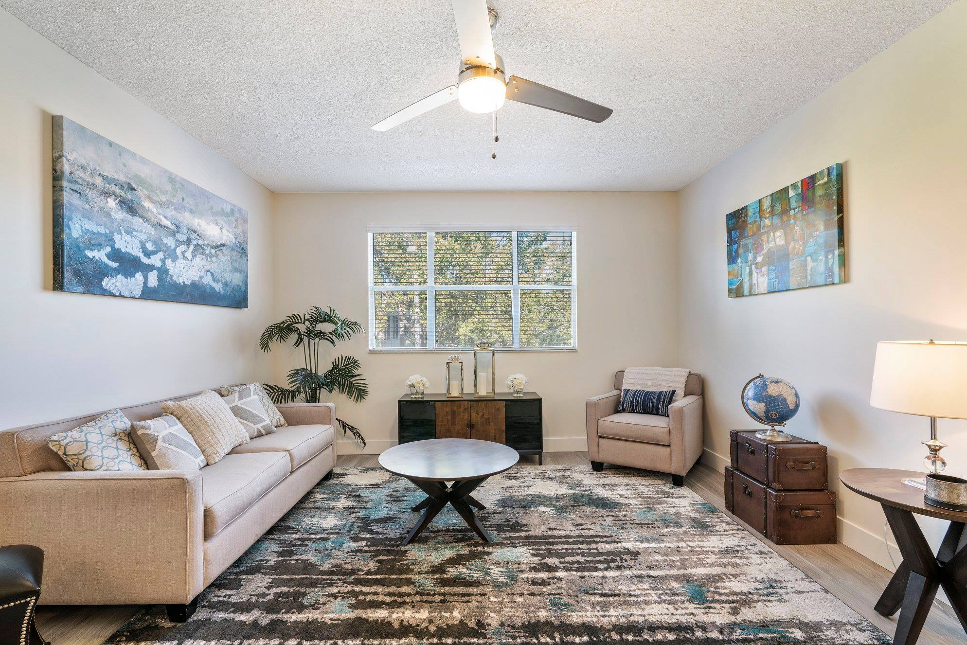 Living Room with Ceiling Fan at Windsor Castle Apartments in Coral Springs, Florida