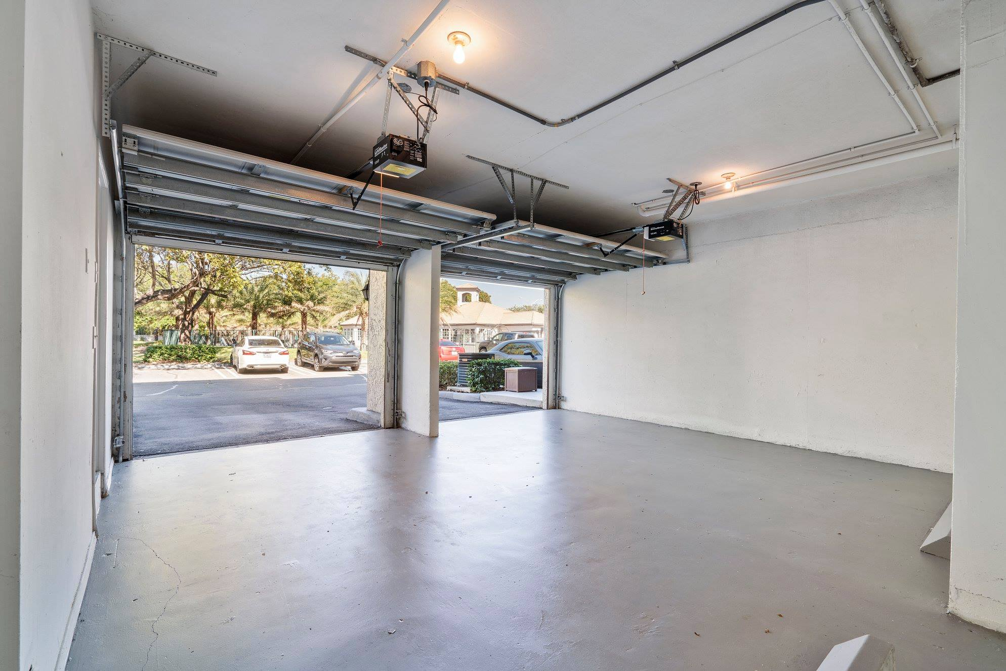 Convenient Garages at Windsor Castle Apartments in Coral Springs, Florida