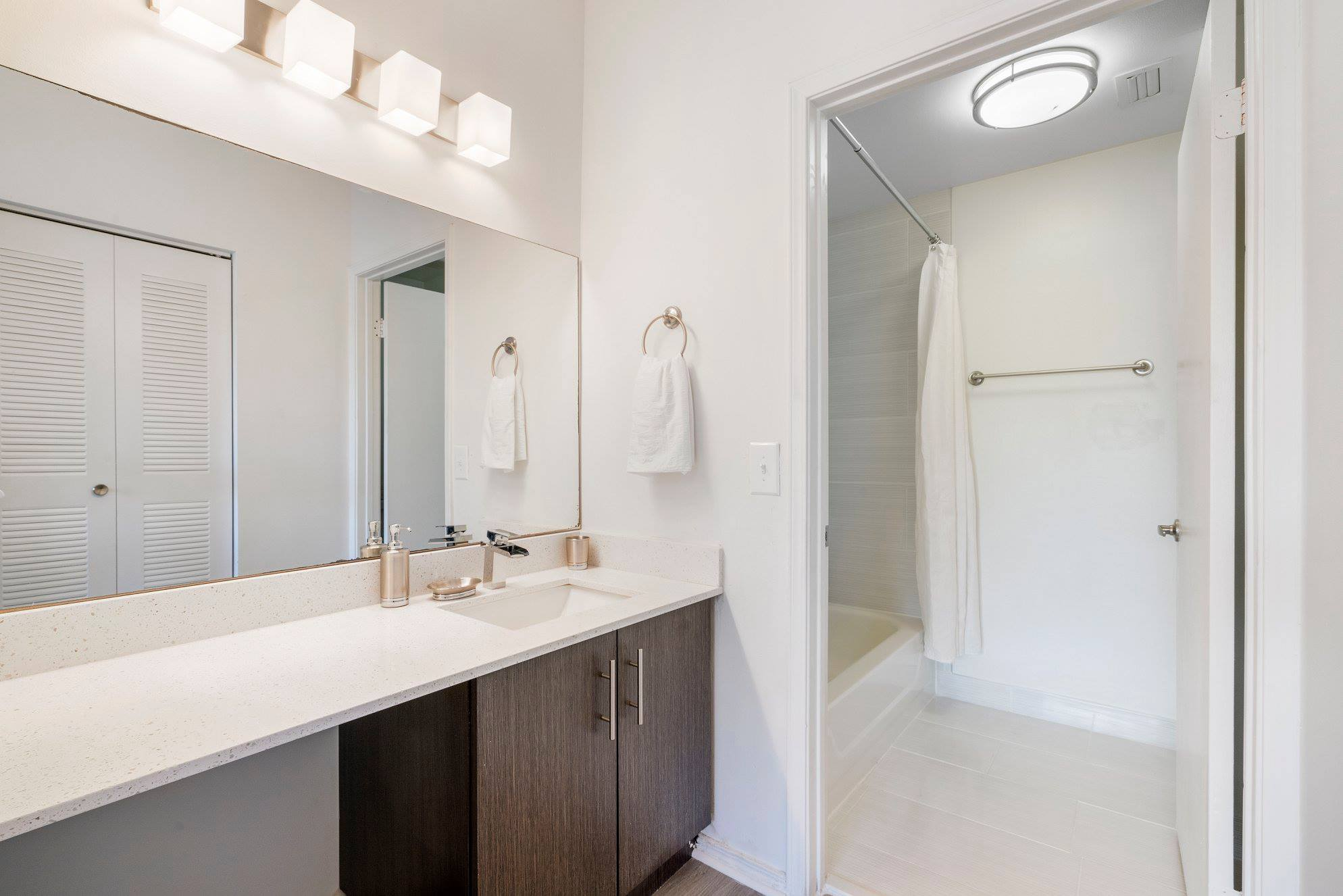 Bathroom with Spacious Vanities at Windsor Castle Apartments in Coral Springs, Florida