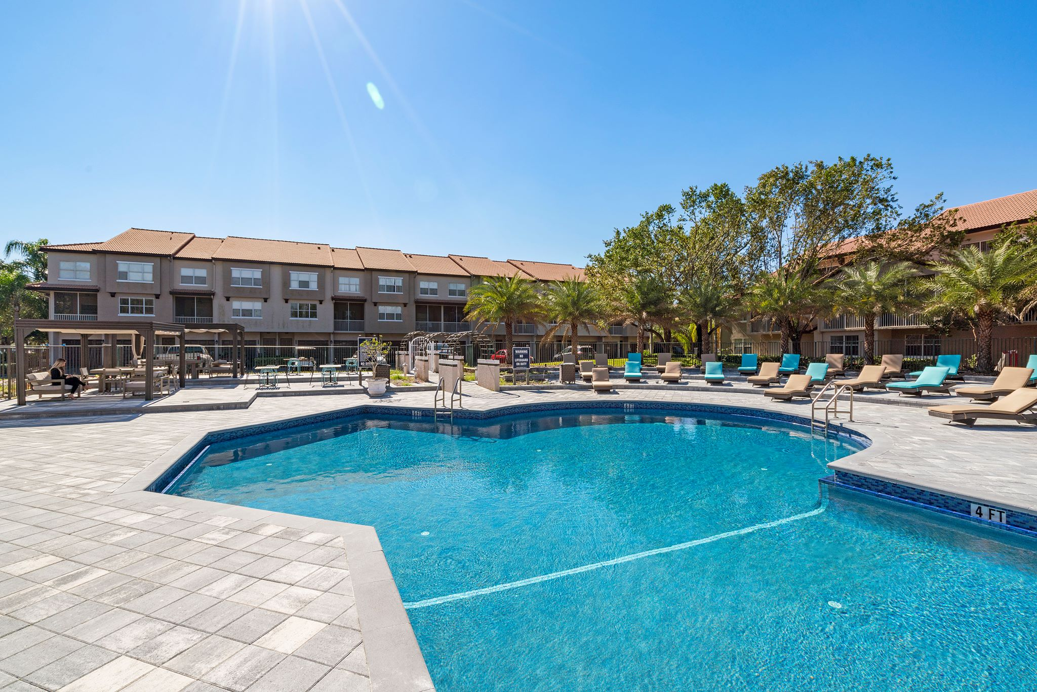 Sparkling Swimming Pool at Windsor Castle Apartments in Coral Springs, Florida