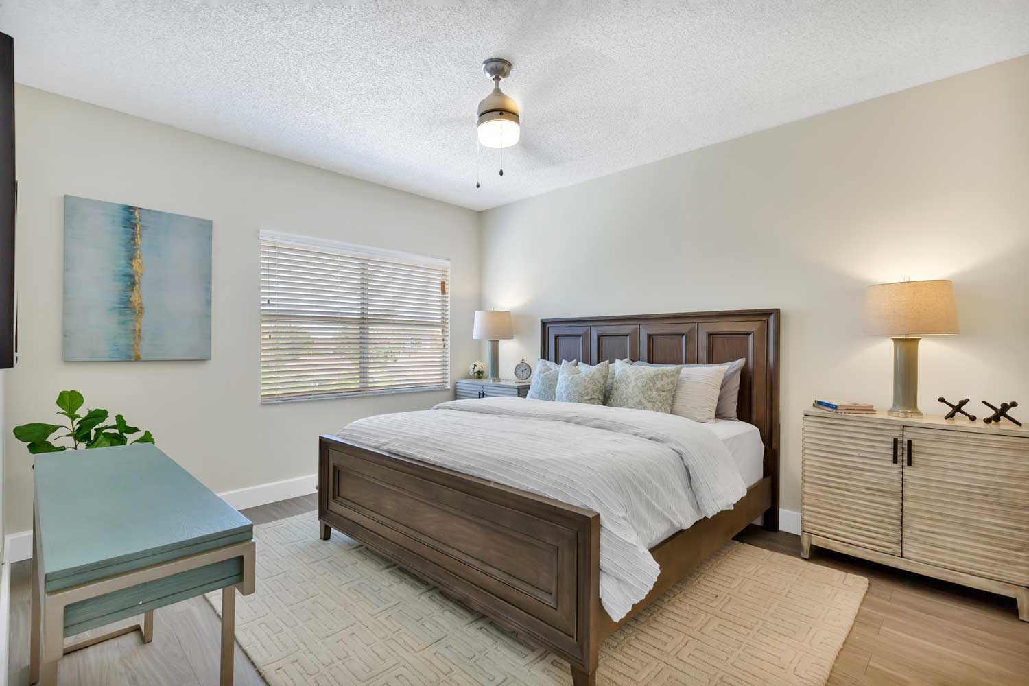 Spacious Master Bedroom with a King Size Bed at Windsor Castle Apartments in Coral Springs, Florida