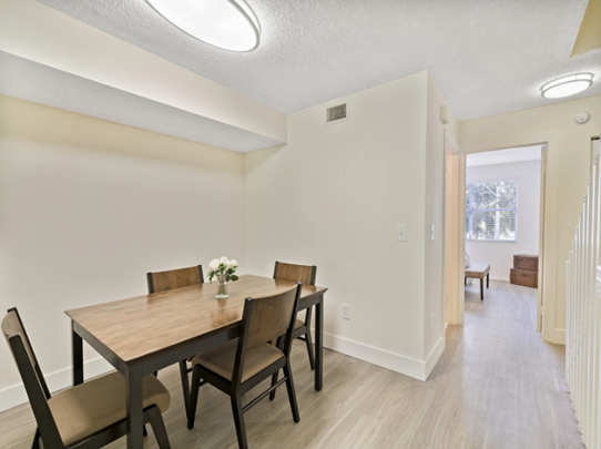 Dining Area  at Windsor Castle Apartments in Coral Springs, Florida