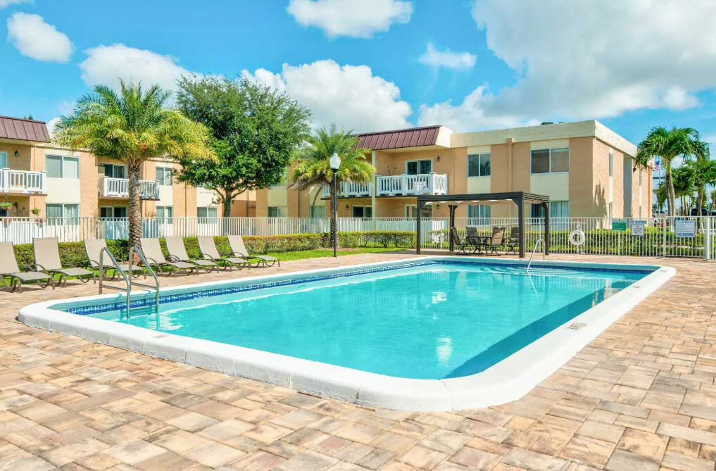 Sparkling Swimming Pool at Windsor Forest Apartments in Pompano Beach, FL