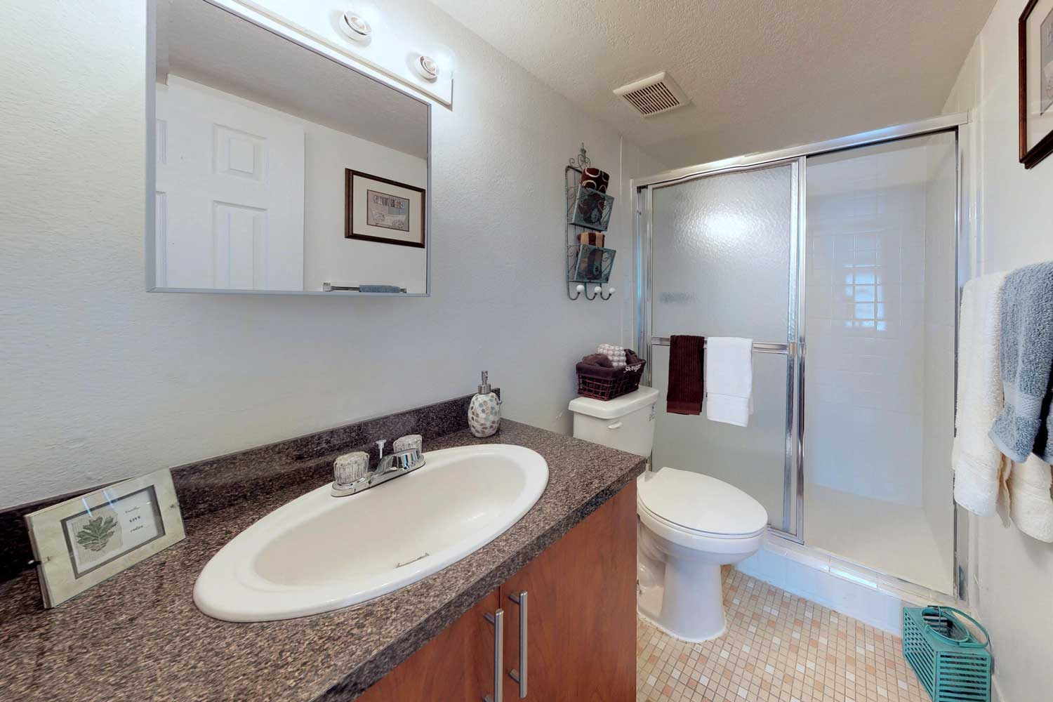 Shower with Sliding Glass Door at Windsor Forest Apartments in Pompano Beach, FL