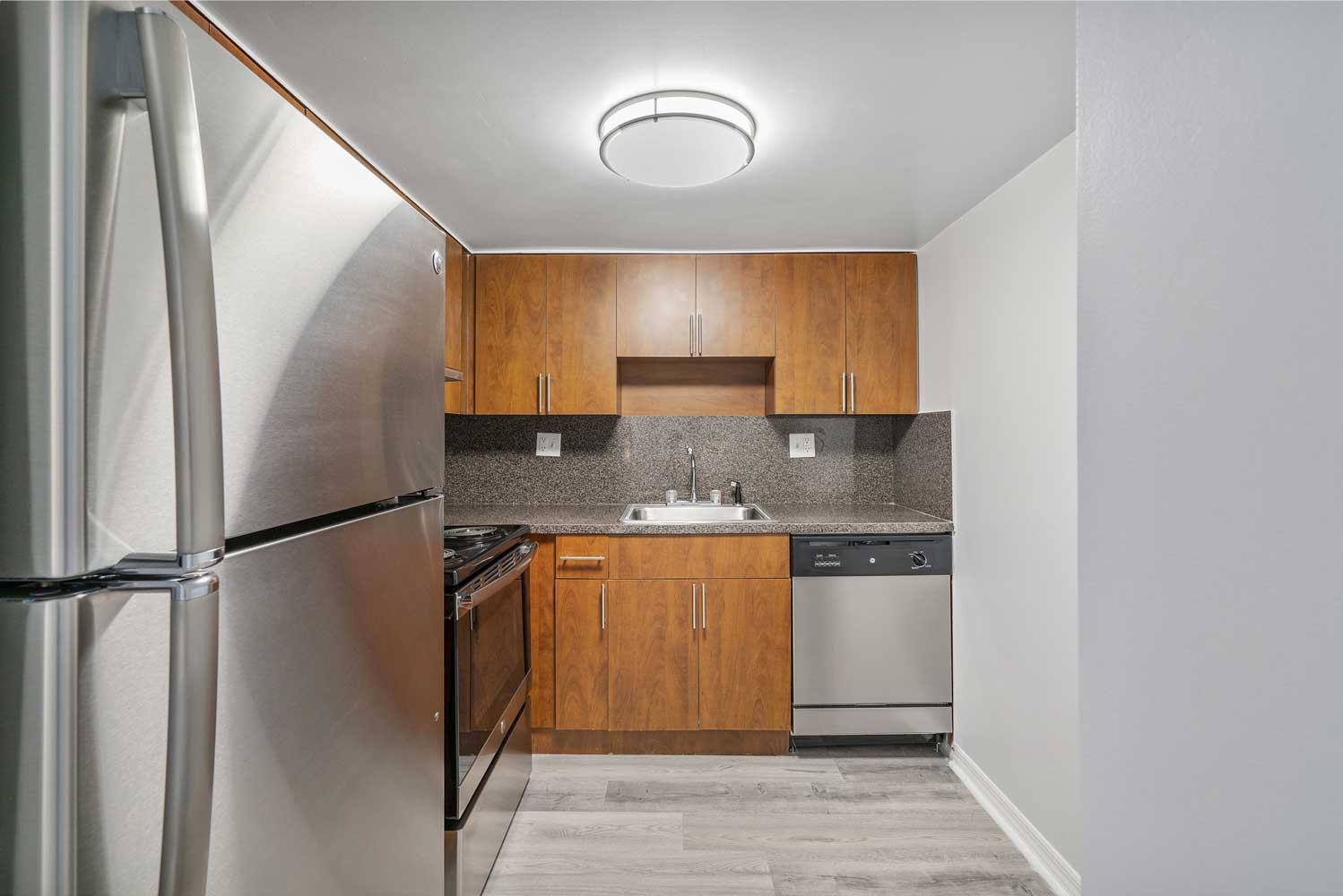 Renovated Kitchen at Windsor Forest Apartments in Pompano Beach, FL