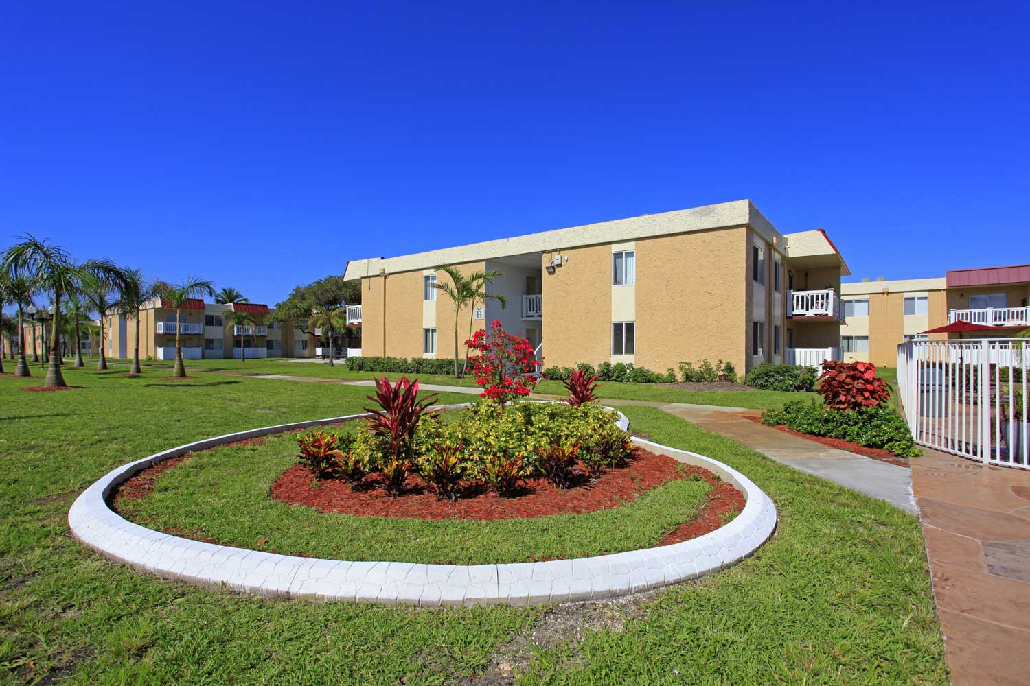 Lush, Green Outdoor Spaces at Windsor Forest Apartments in Pompano Beach, FL
