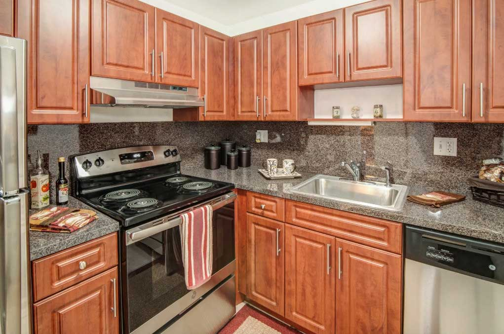 Ample Kitchen Cabinet Storage at Windsor Forest Apartments in Pompano Beach, FL