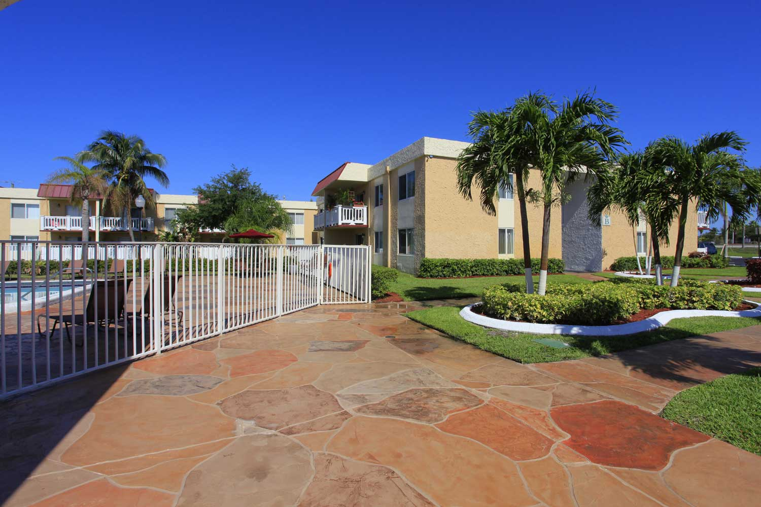 Gated Swimming Pool at Windsor Forest Apartments in Pompano Beach, FL