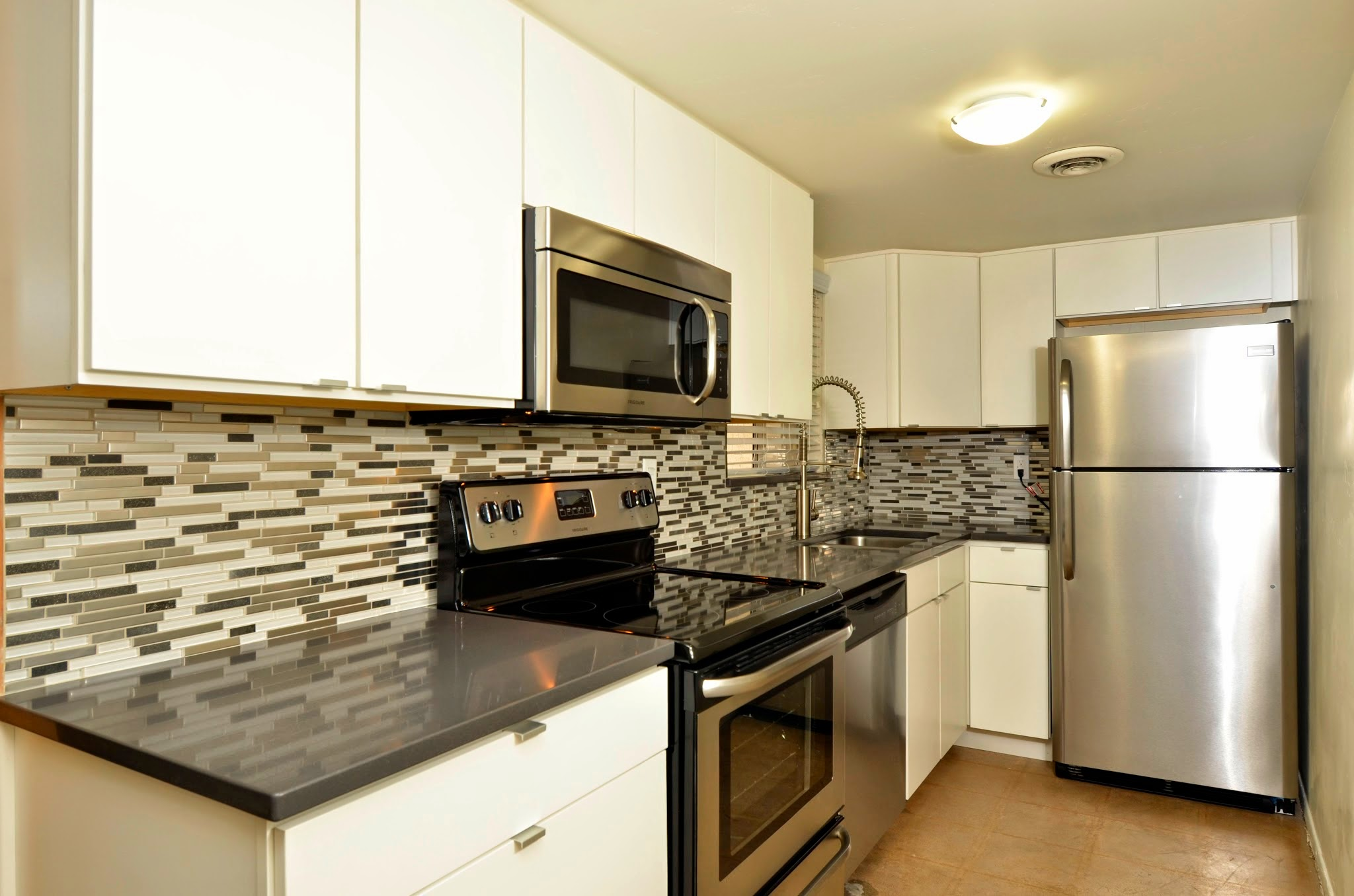 Contemporary Kitchen with Backsplash at The Winfield of Scottsdale Apartments in Scottsdale, Arizona