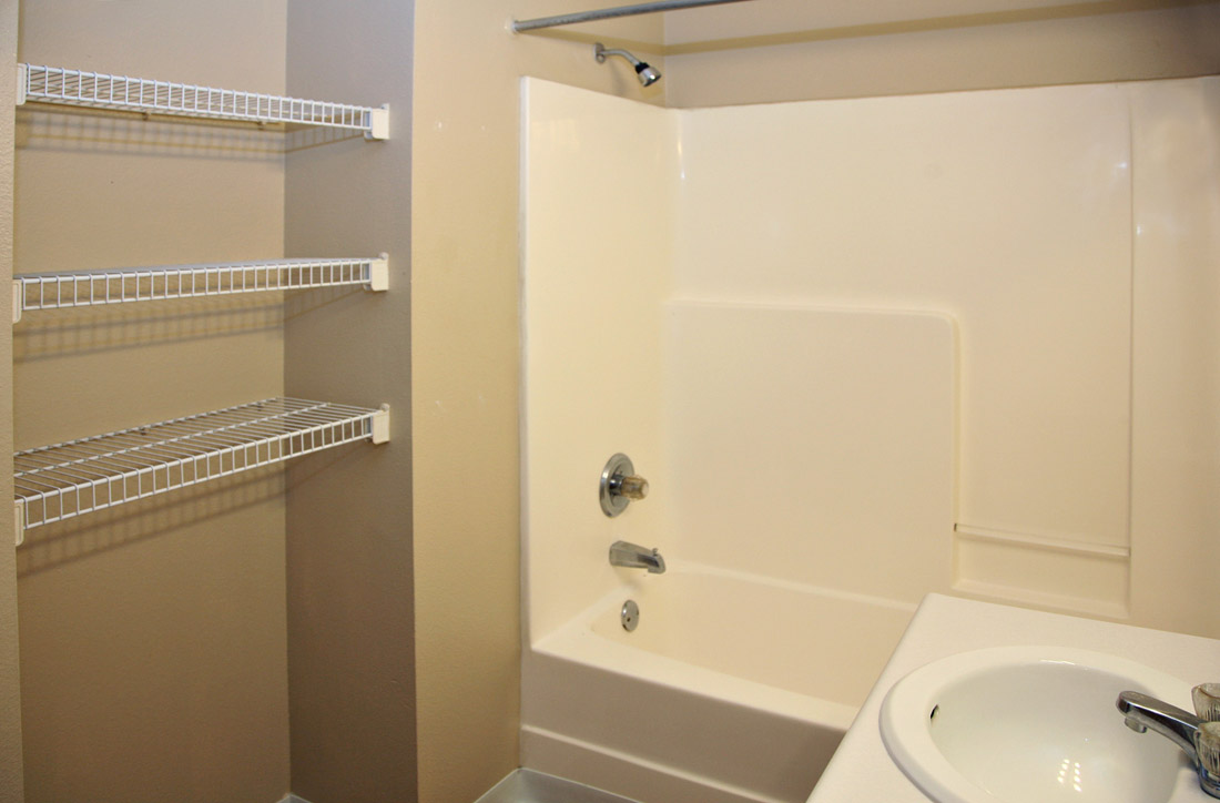 Updated Bathrooms with Storage at Woodbury Heights Apartments in Sioux City, IA