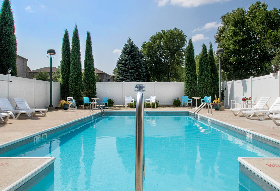 Pool Lounge Area at Woodbury Heights Apartments in Sioux City, IA