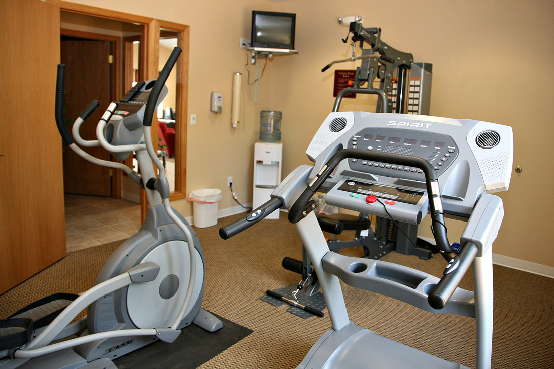 Modern Gym Cardio Equipment at Woodbury Heights Apartments in Sioux City, IA