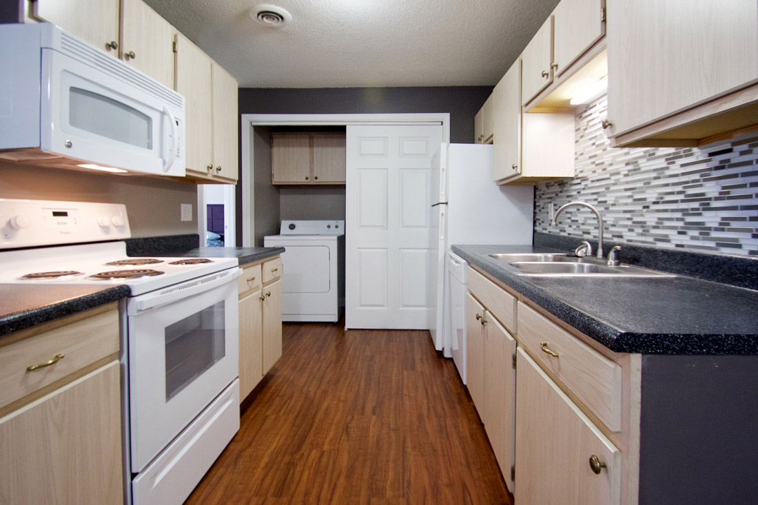 Stylish Kitchen Backsplash and Touches at Woodbury Heights Apartments in Sioux City, IA