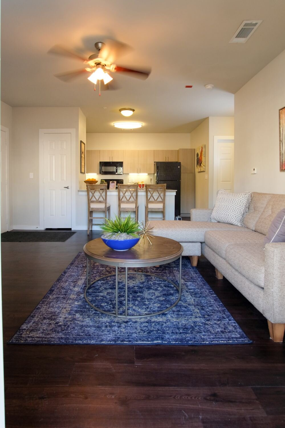 Wood-Style Plank Flooring at Woodcreek Apartments in Woodcreek, Texas