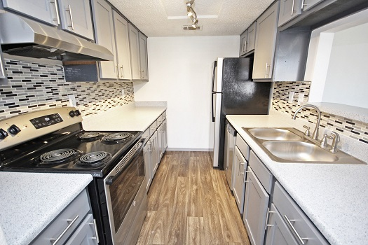 Loads of Countertop Space at The Woodlands Apartments in Fort Worth, Texas