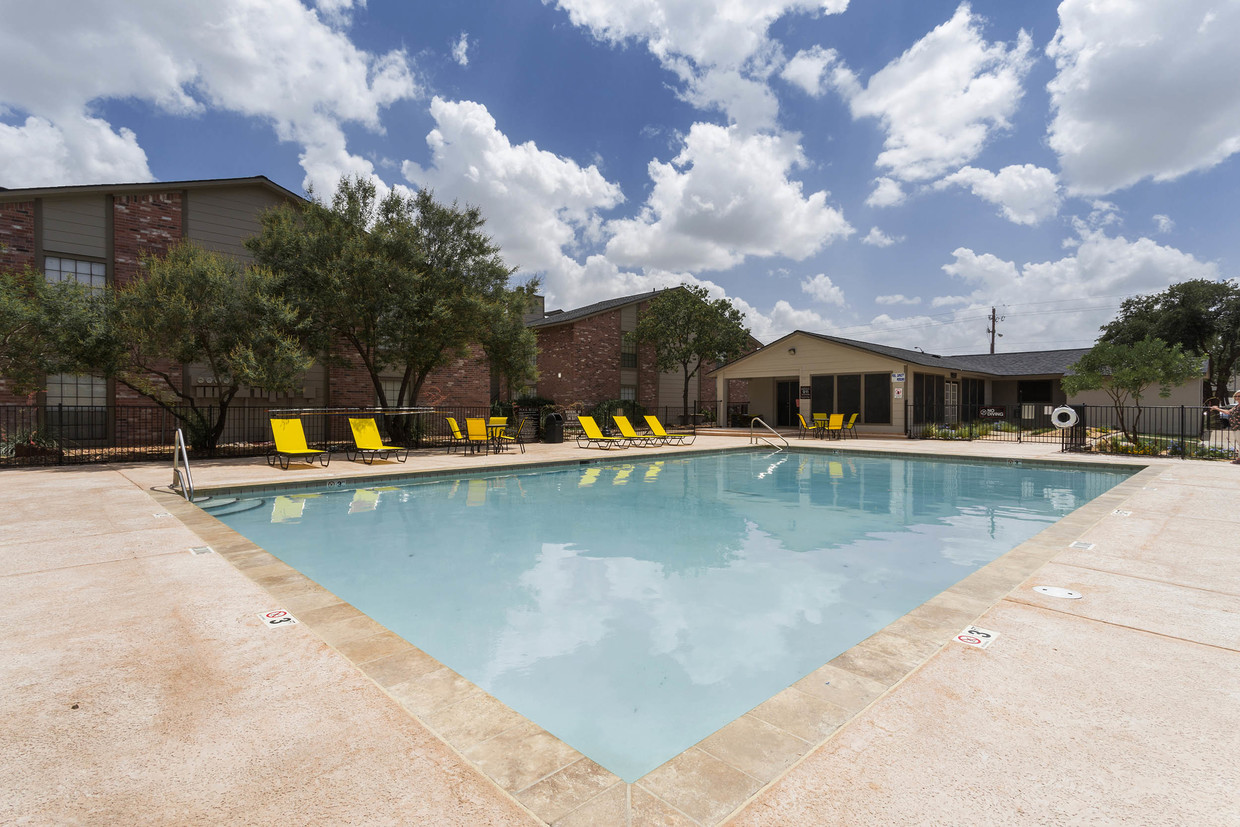 Pool with Sundeck at Woodlands Apartments in Odessa, Texas