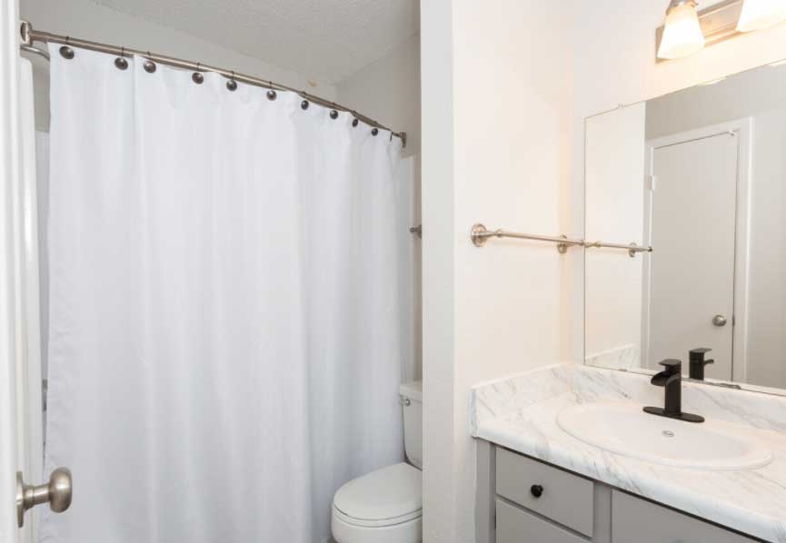 Bathroom at Woodlands Apartments in Odessa, Texas