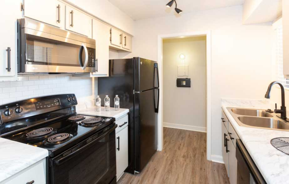 Kitchen at Woodlands Apartments in Odessa, Texas