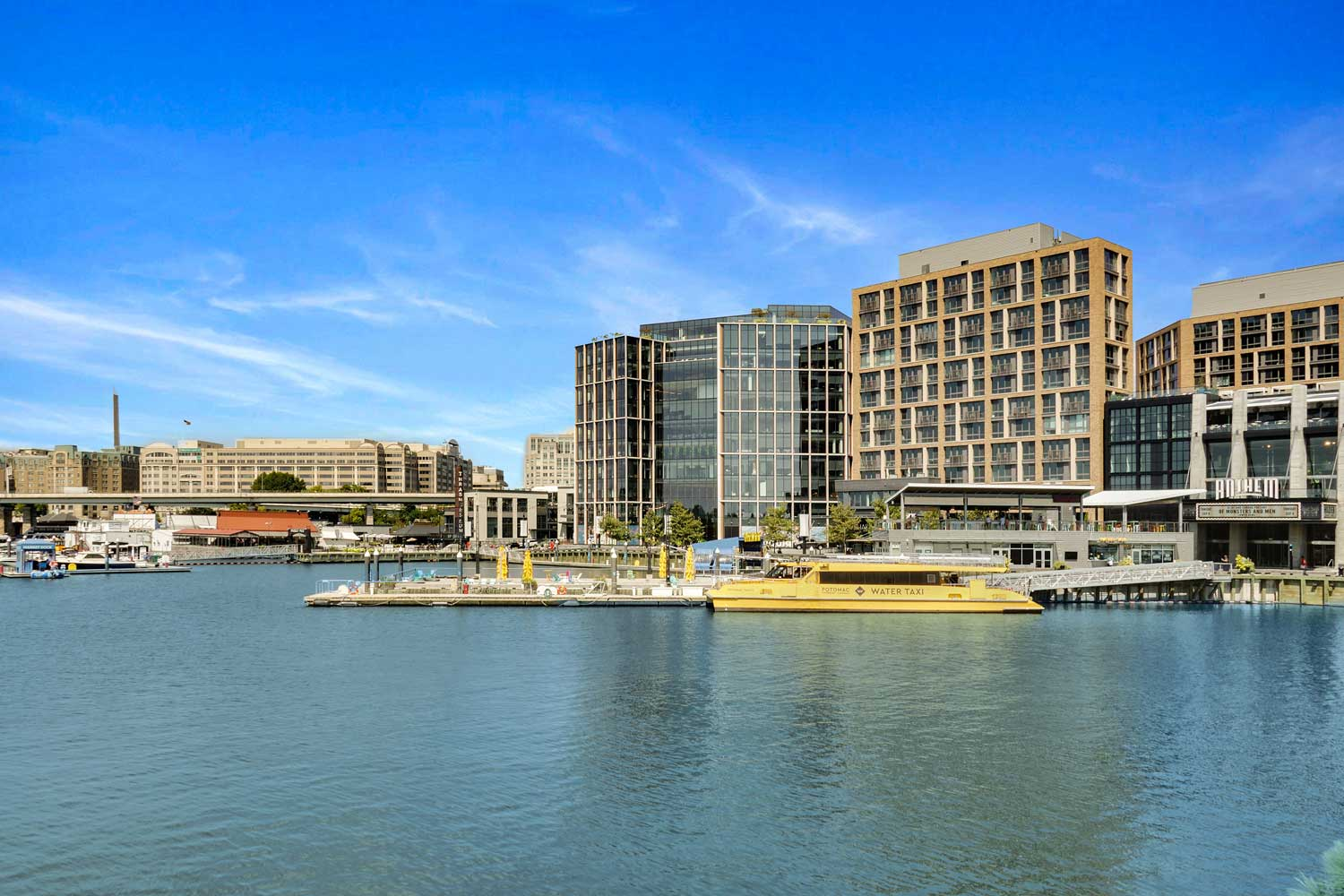 The Wharf DC is 15 minutes from Woodmont Park Apartments in Alexandria, VA