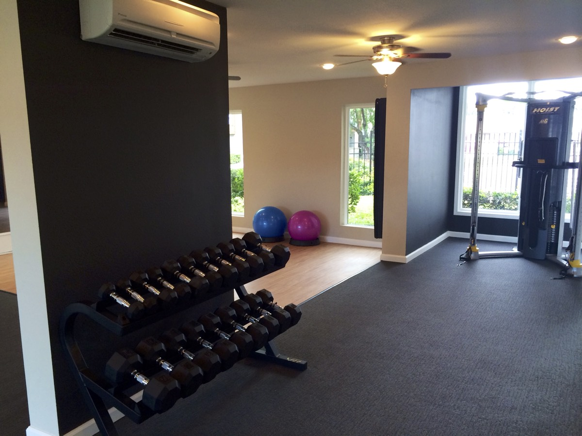 Free Weights at Woods at Spring Grove Apartments in Houston, Texas