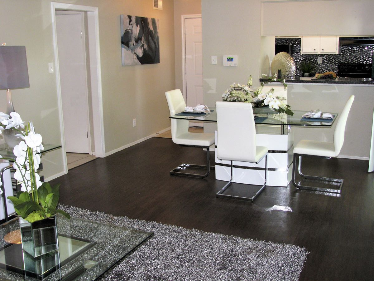 Sleek, Hardwood-Look Flooring at Woods at Spring Grove Apartments in Houston, Texas