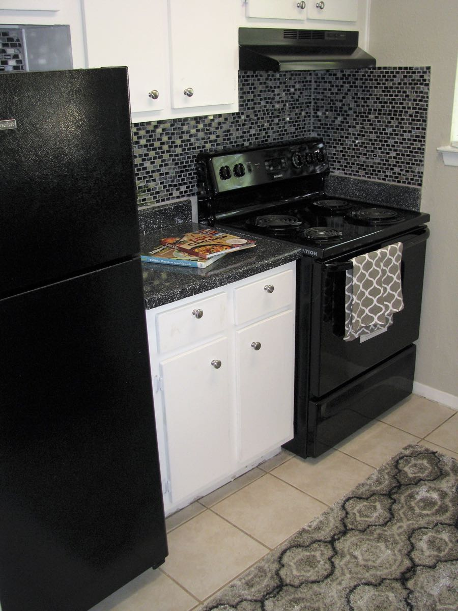 Black Appliances at Woods at Spring Grove Apartments in Houston, Texas