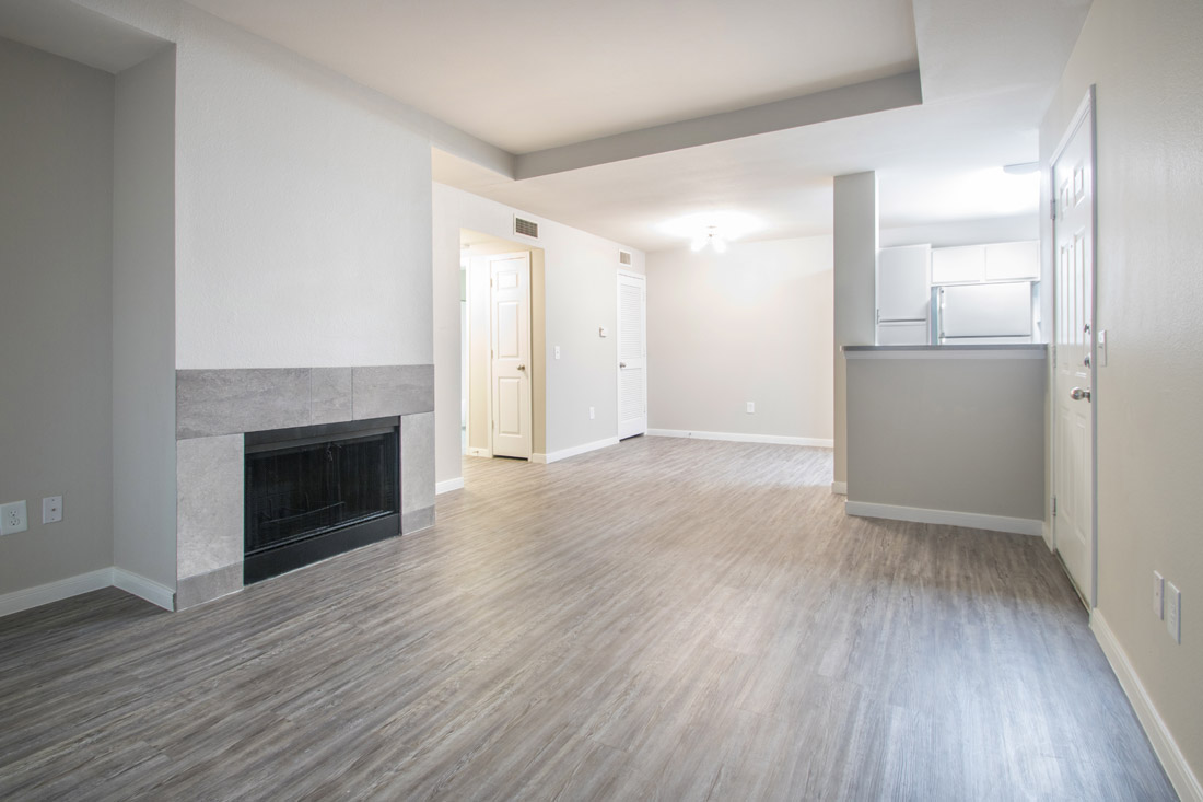 Living Room with Fireplace at Wyndham Apartments in Lubbock, TX.